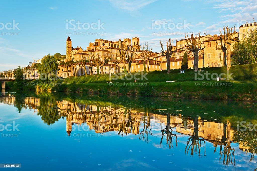 Cityscape of Auch reflecting in Gers River stock photo
