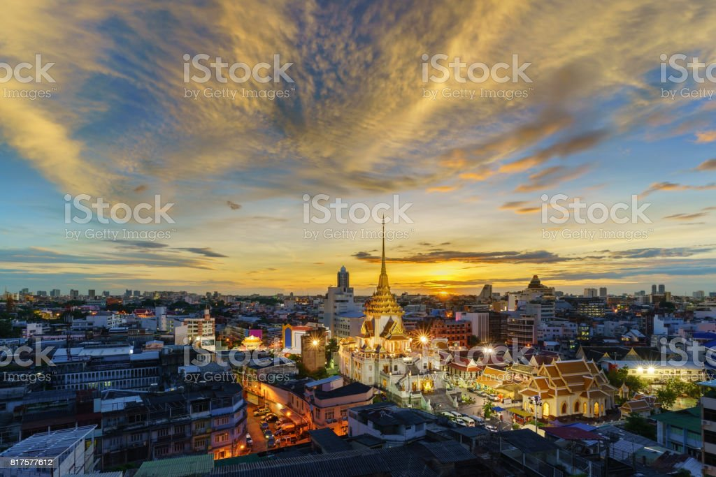 Cityscape of beautiful Wat Traimit or Temple of the Golden Buddha where the biggest solid golden Buddha statue is installed near the Chinatown , Bangkok , Thailand stock photo