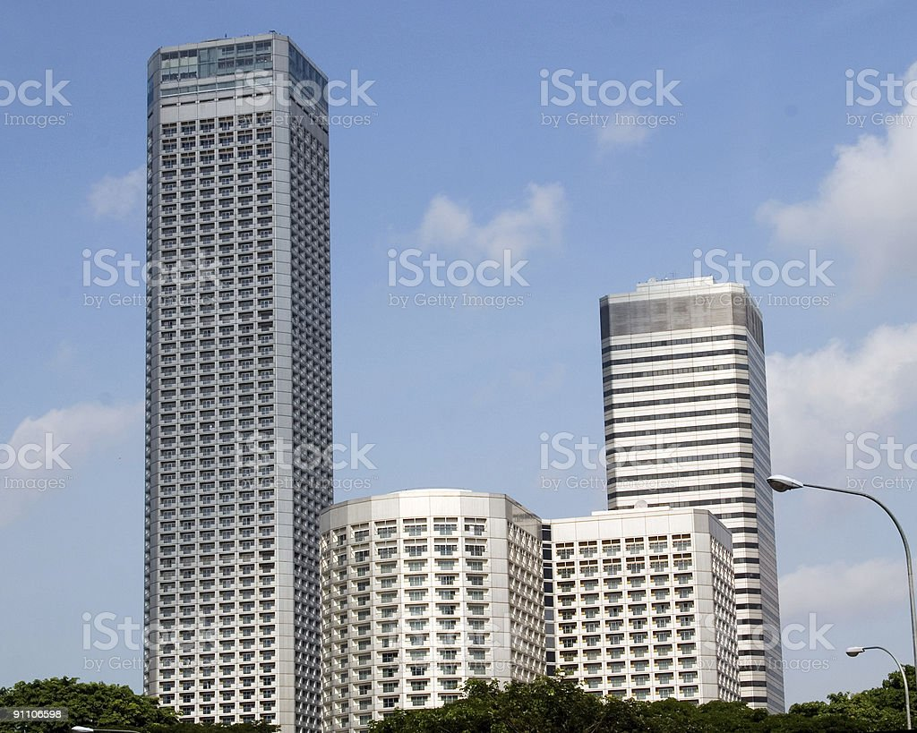 cityscape of four hi-tech buildings isolated in sky stock photo