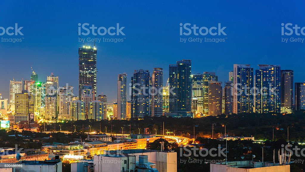 Cityscape of manila at night stock photo