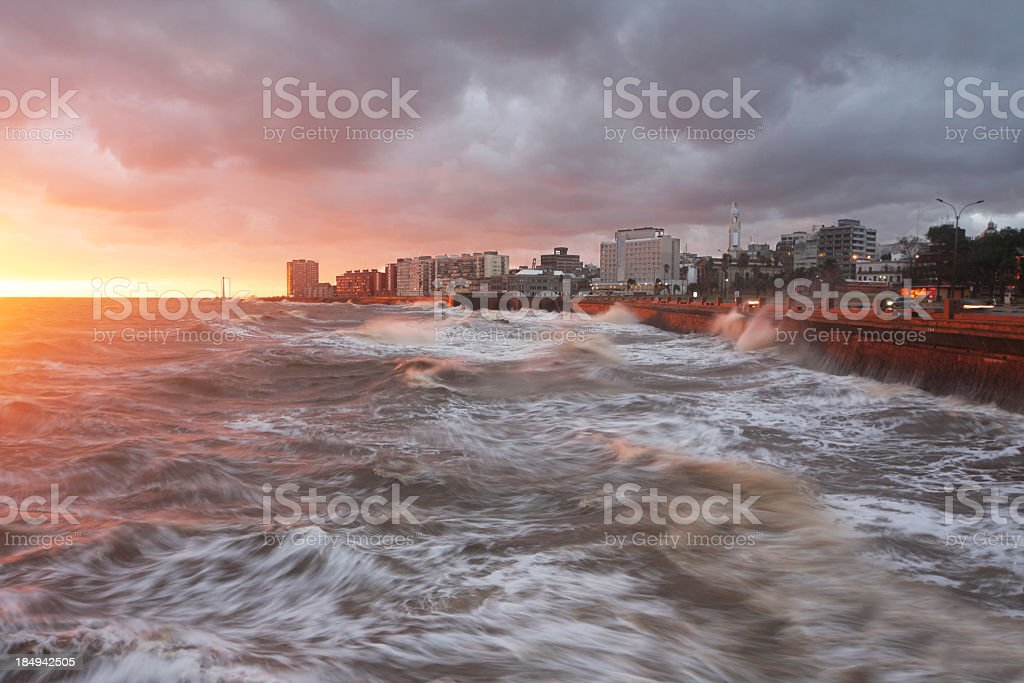 Cityscape of Montevideo at the river in stormy sunset stock photo