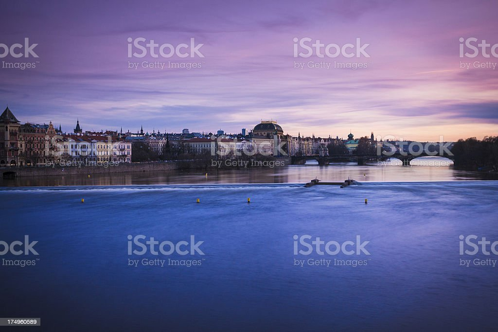 Cityscape of Prague at Dusk with Vltava river royalty-free stock photo