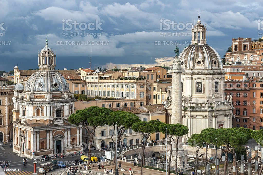 Cityscape of Rome with churches and stormy clouds. stock photo