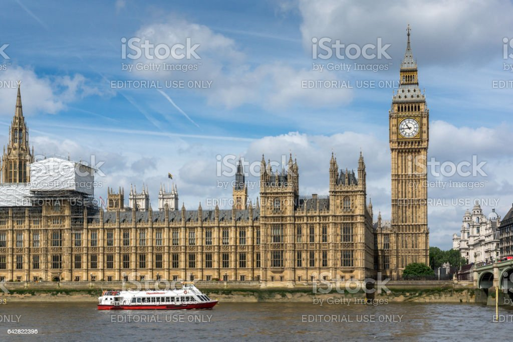 LONDON, ENGLAND - JUNE 19 2016: Cityscape of Westminster Palace and Thames River, London, England stock photo