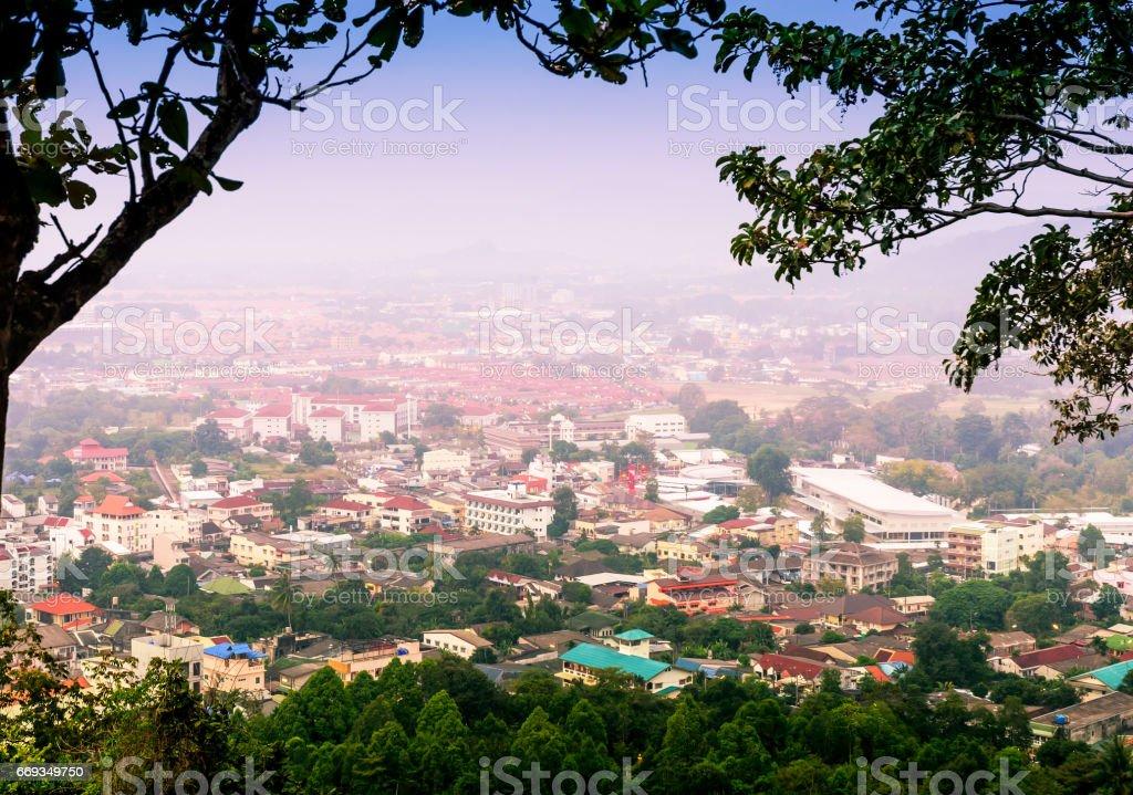 Cityscape on mountain in mist stock photo