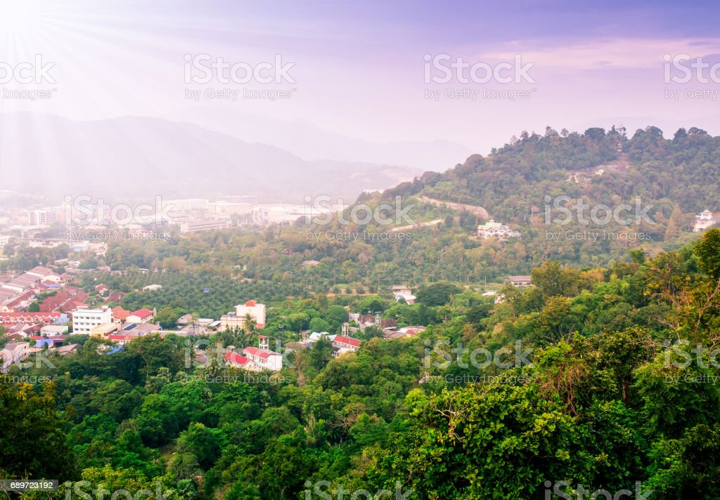 Cityscape on mountain landscape nature with sunbeam and fog stock photo