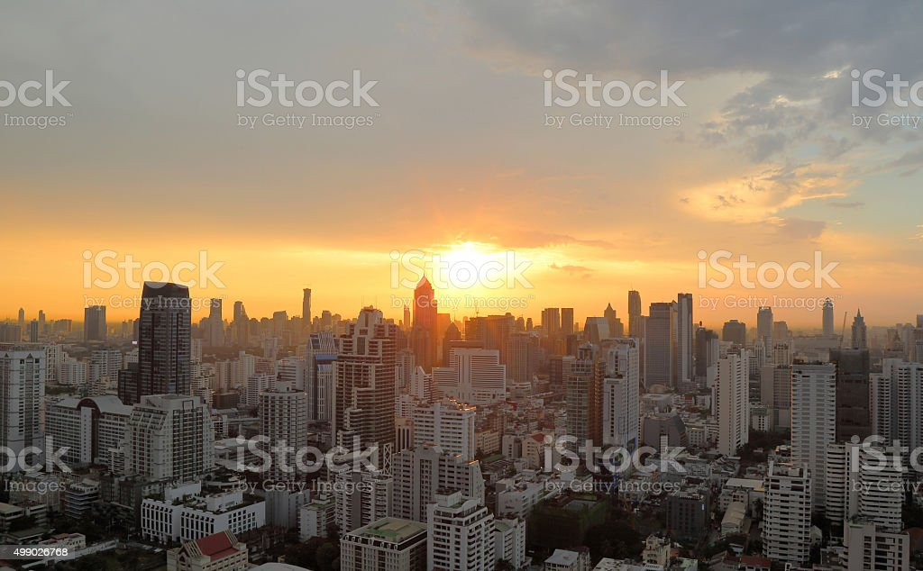 Cityscape sunset at evening time stock photo
