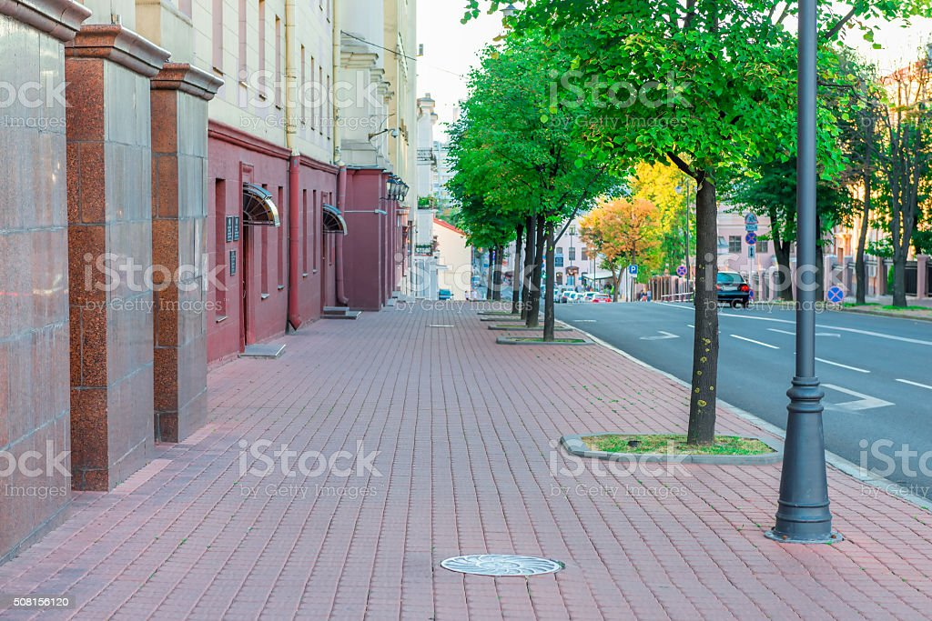 Cityscape - the sidewalk along the road stock photo