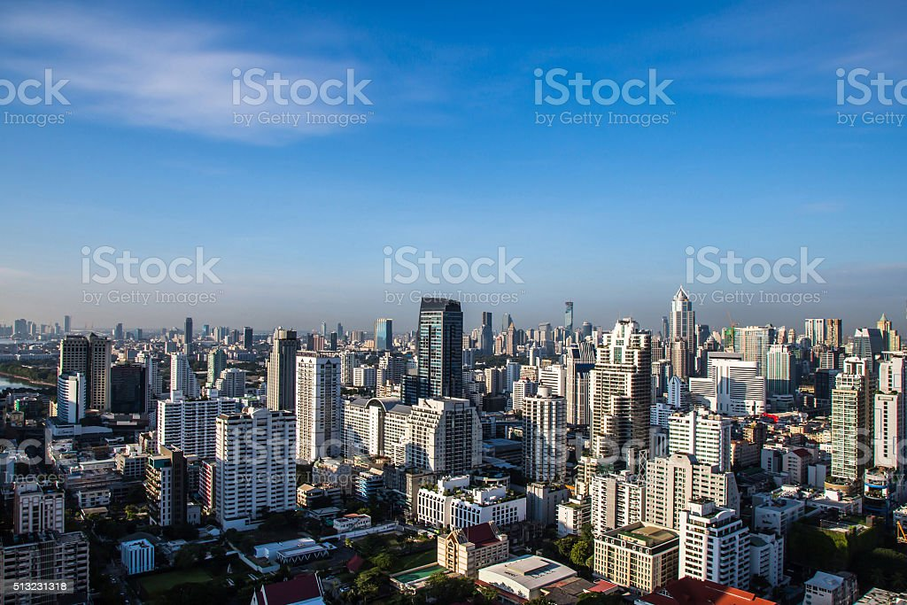 Cityscape under clouds and blue sky. stock photo