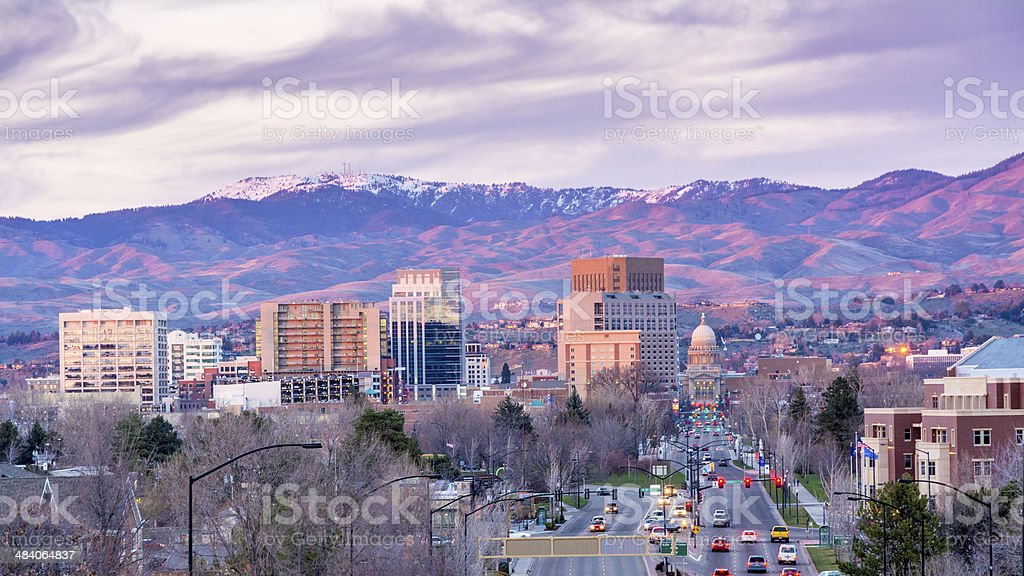 Cityscape with hills and cars stock photo