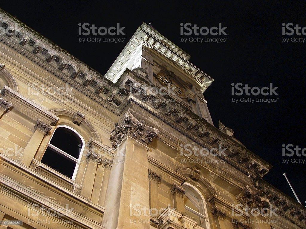 civic clocktower at night stock photo
