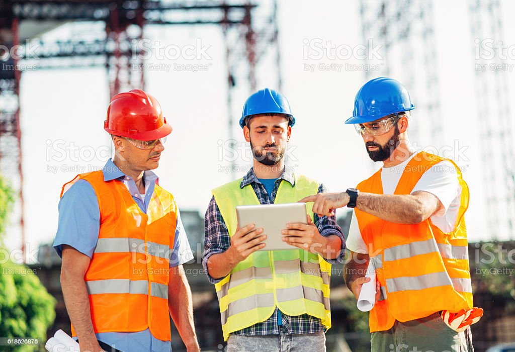 Civic engineers on construction site stock photo