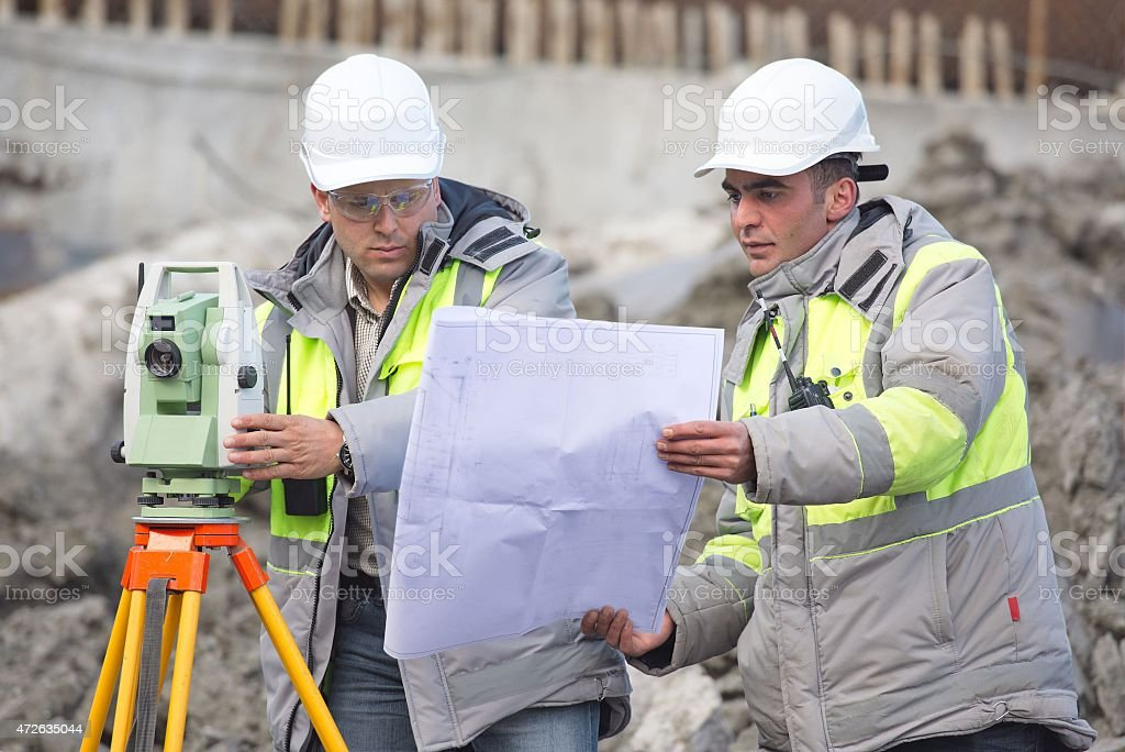 Civil Engineer and Surveyor At Consruction Site stock photo