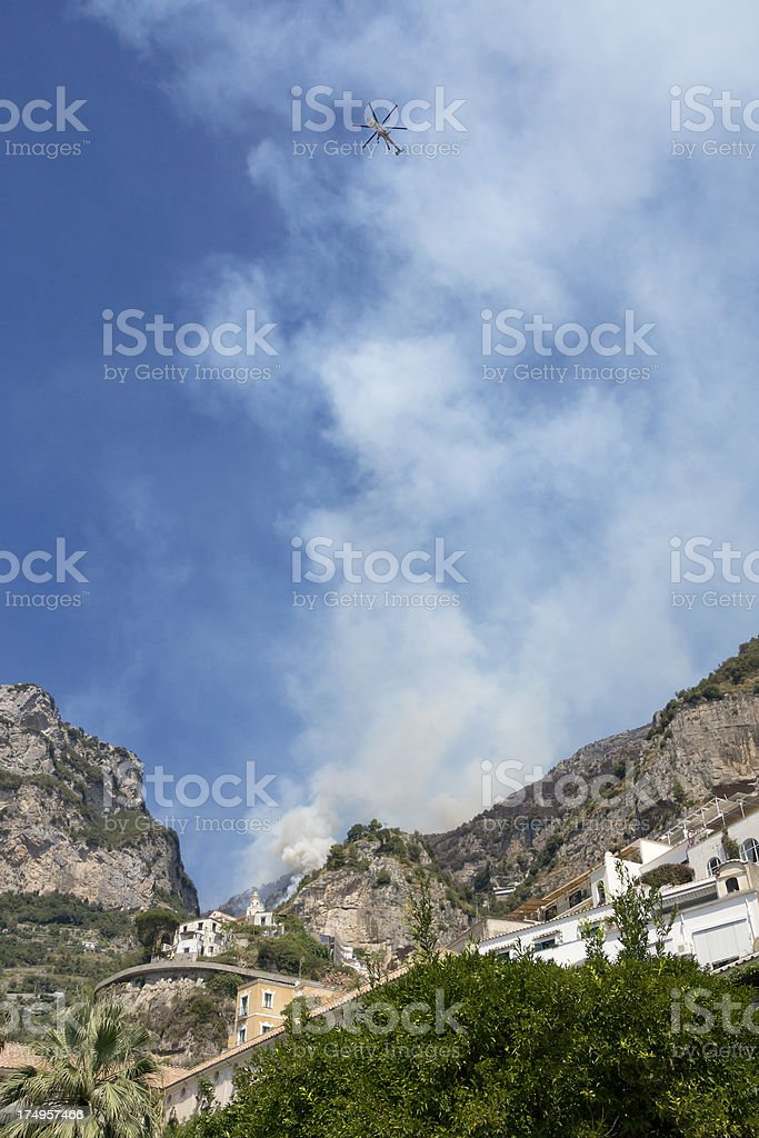 Civil protection helicopter extinguishing a fire royalty-free stock photo