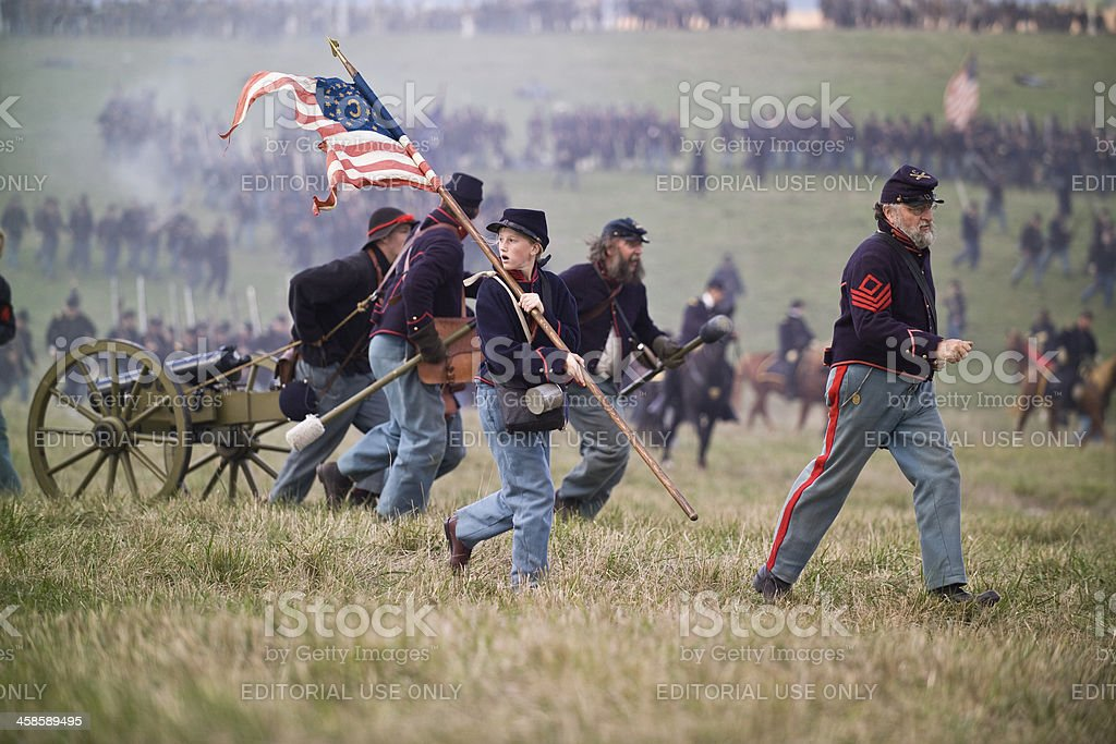 Civil War Reenactment Soldiers Running With Artillery Piece stock photo