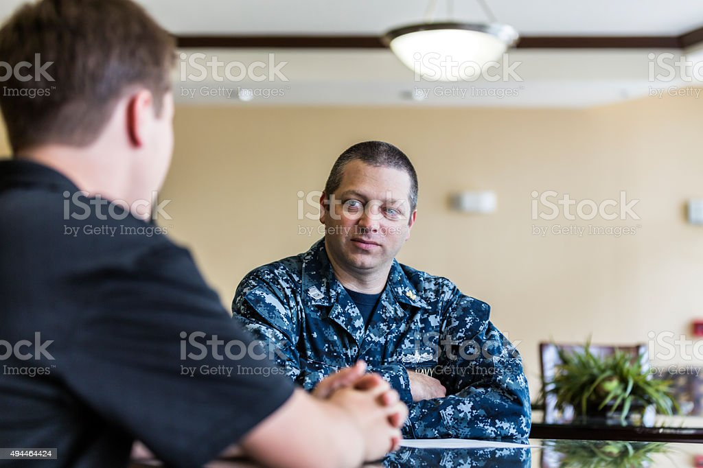 Civilian Teenager Meeting With US Navy Recruiter stock photo