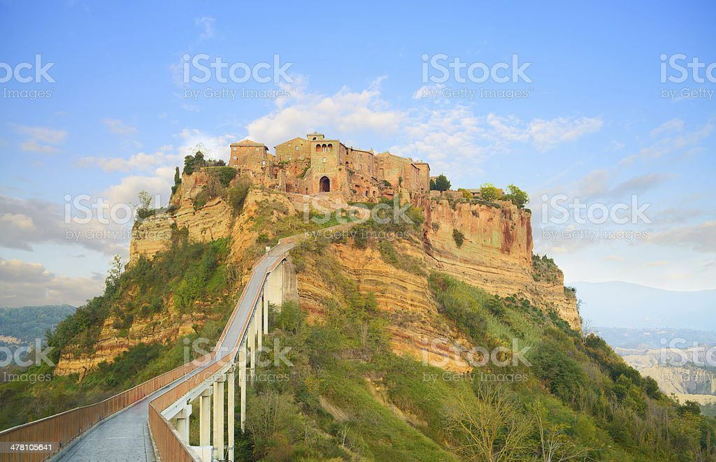 Civita di Bagnoregio landmark, bridge view on sunset. Italy stock photo