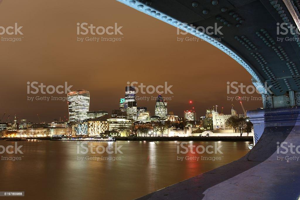 Ciy of London from Tower Bridge London England at night stock photo
