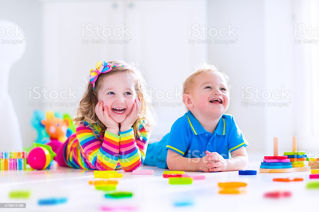 Cjildren playing with wooden toys stock photo