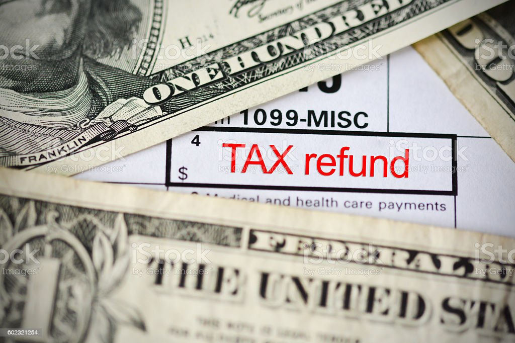 Claim a tax refund concept with form template close up stock photo