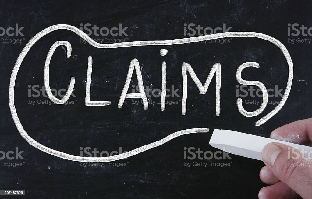 claims handwritten with chalk on a blackboard stock photo
