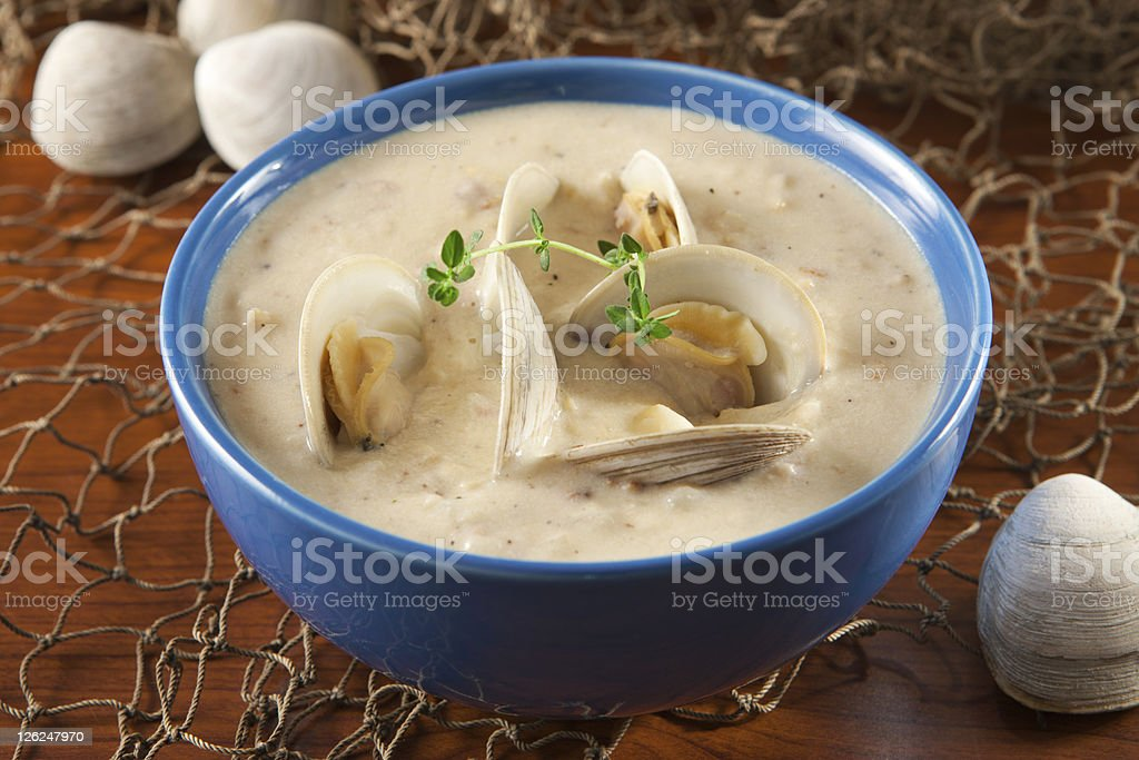 Clam chowder with a sprig of seasoning stock photo