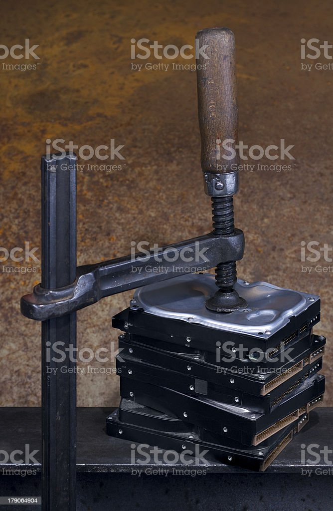 clamp pressing on stack of hard drives stock photo