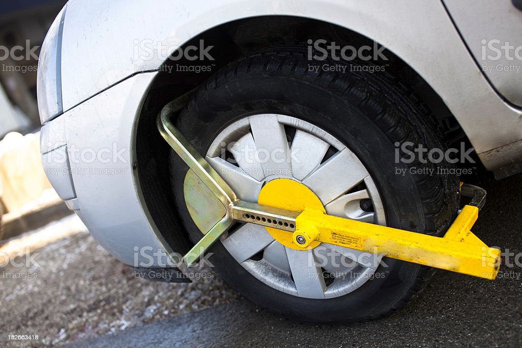 Clamped front wheel in restricted area royalty-free stock photo