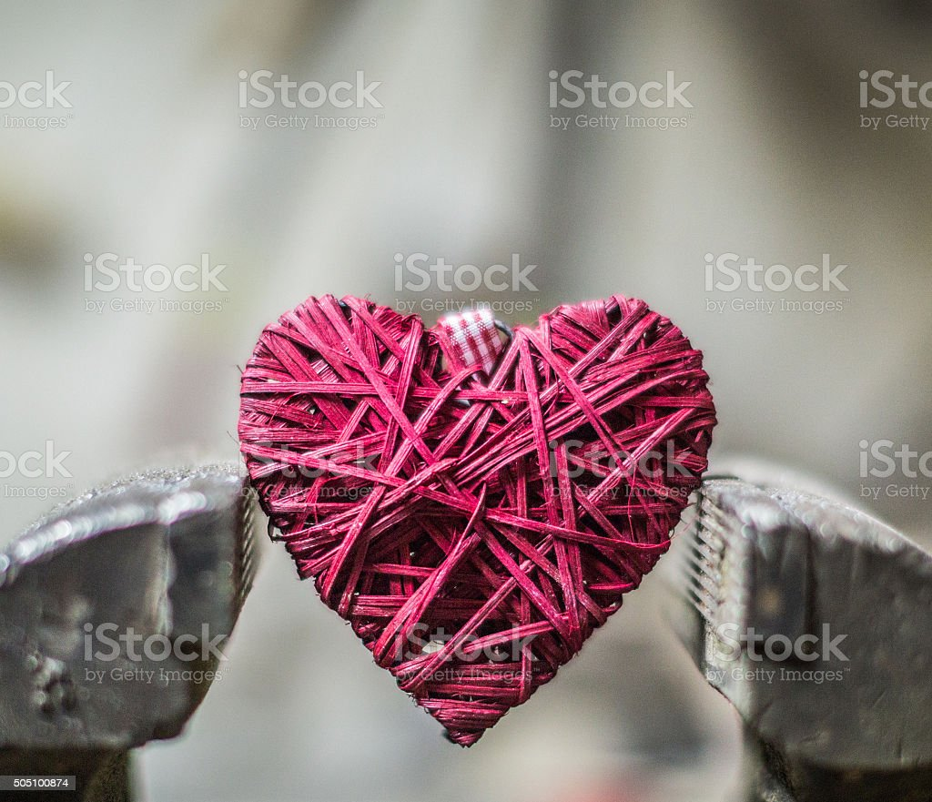 Clamped Heart symbol stock photo