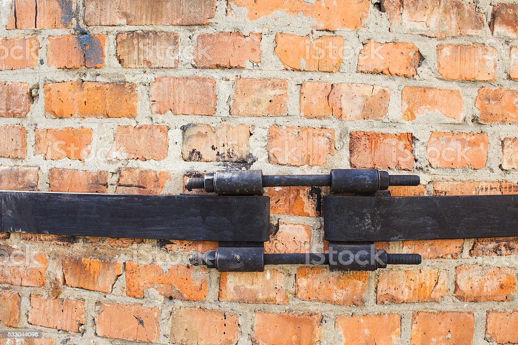 clamping ring at the brick industrial chimney stock photo