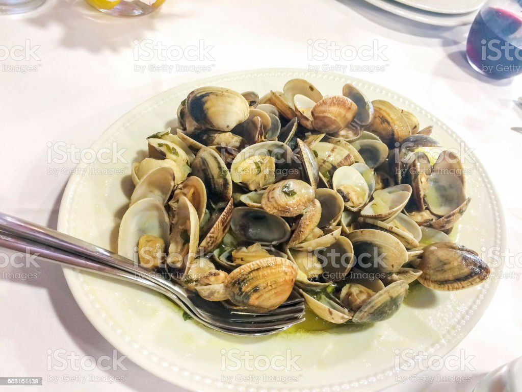 Clams in green sauce stock photo