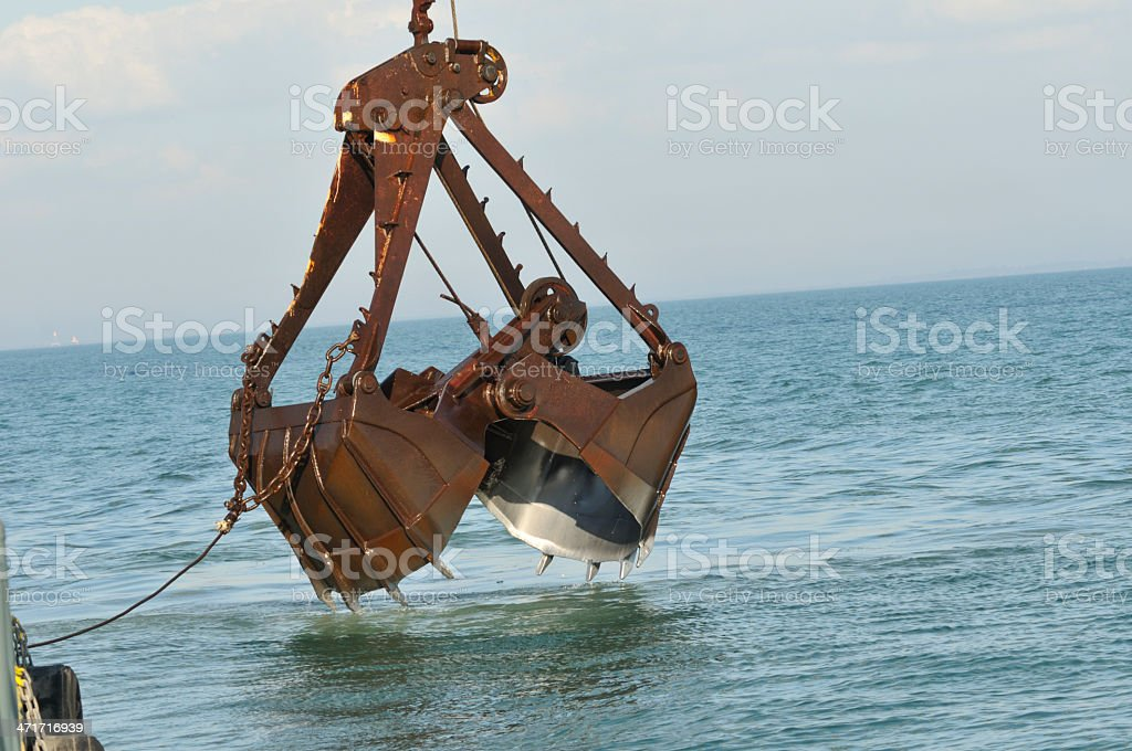 Clamshell dredging bucket stock photo