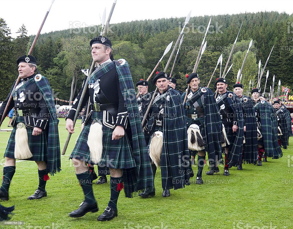 Clansmen marching at the Lonach Gathering in Strathdon, Scotland stock photo