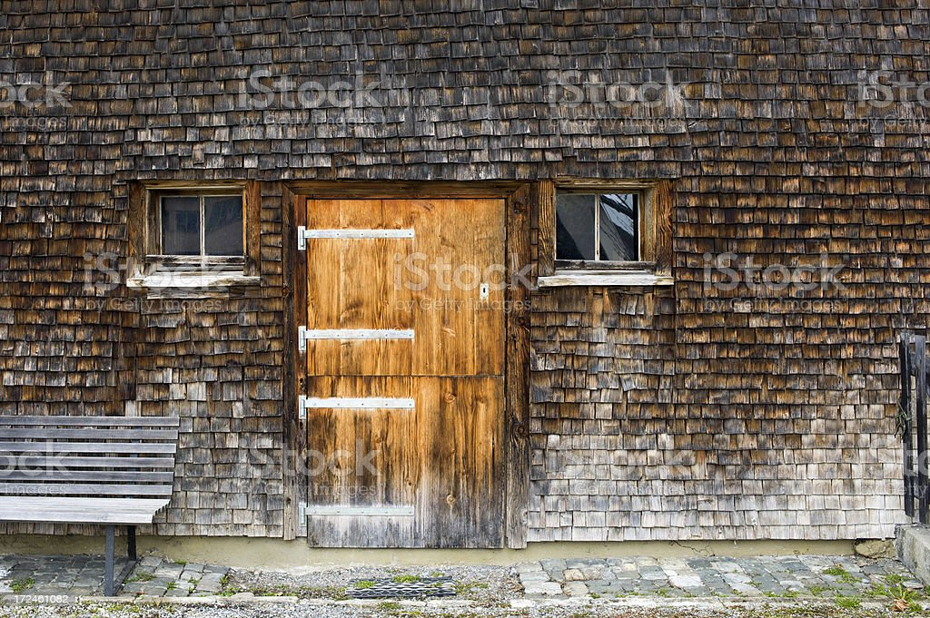 Clapboard house facade with bench royalty-free stock photo