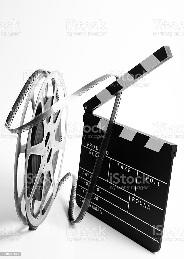 Clapper and film reel stock photo