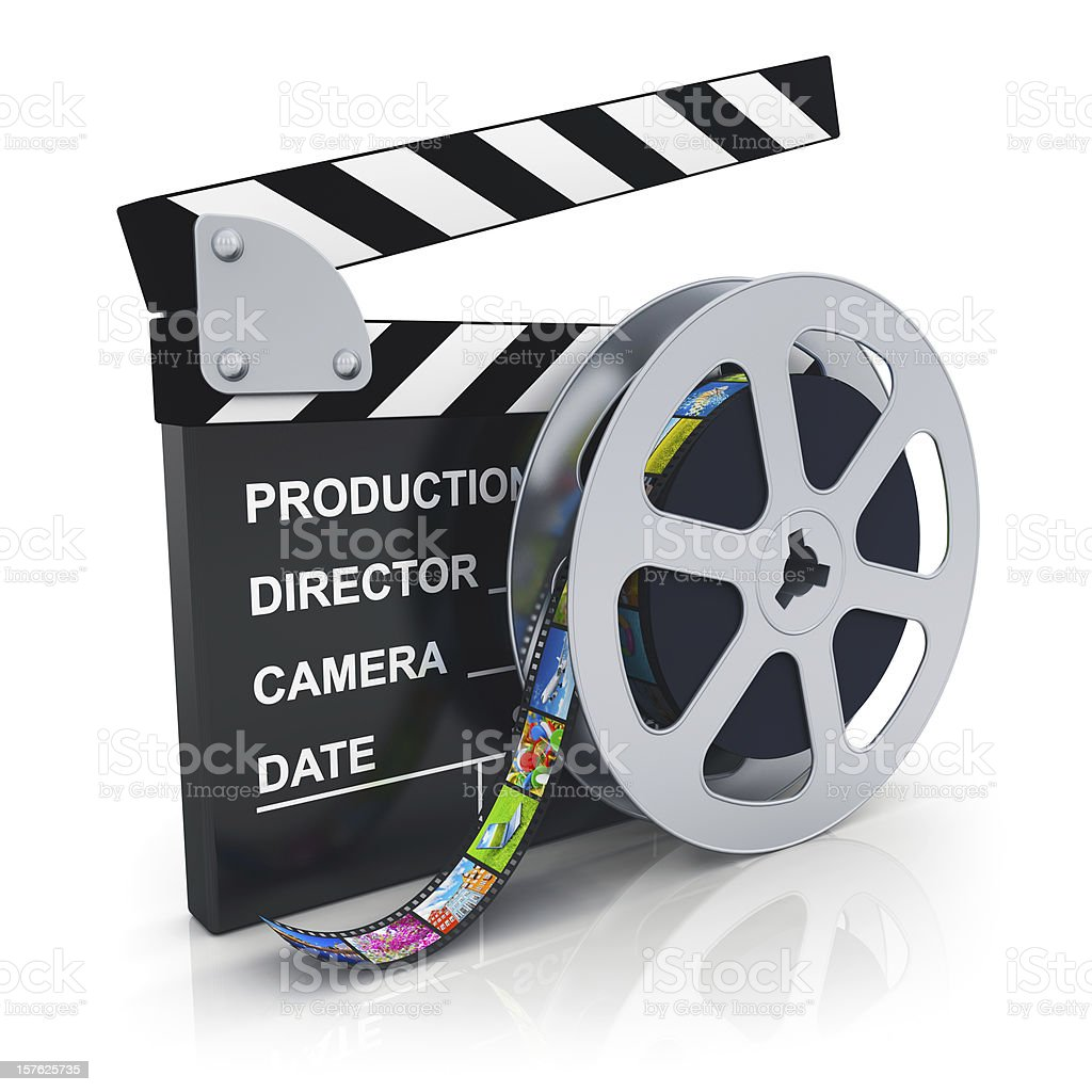 Clapper board and reel with filmstrip stock photo