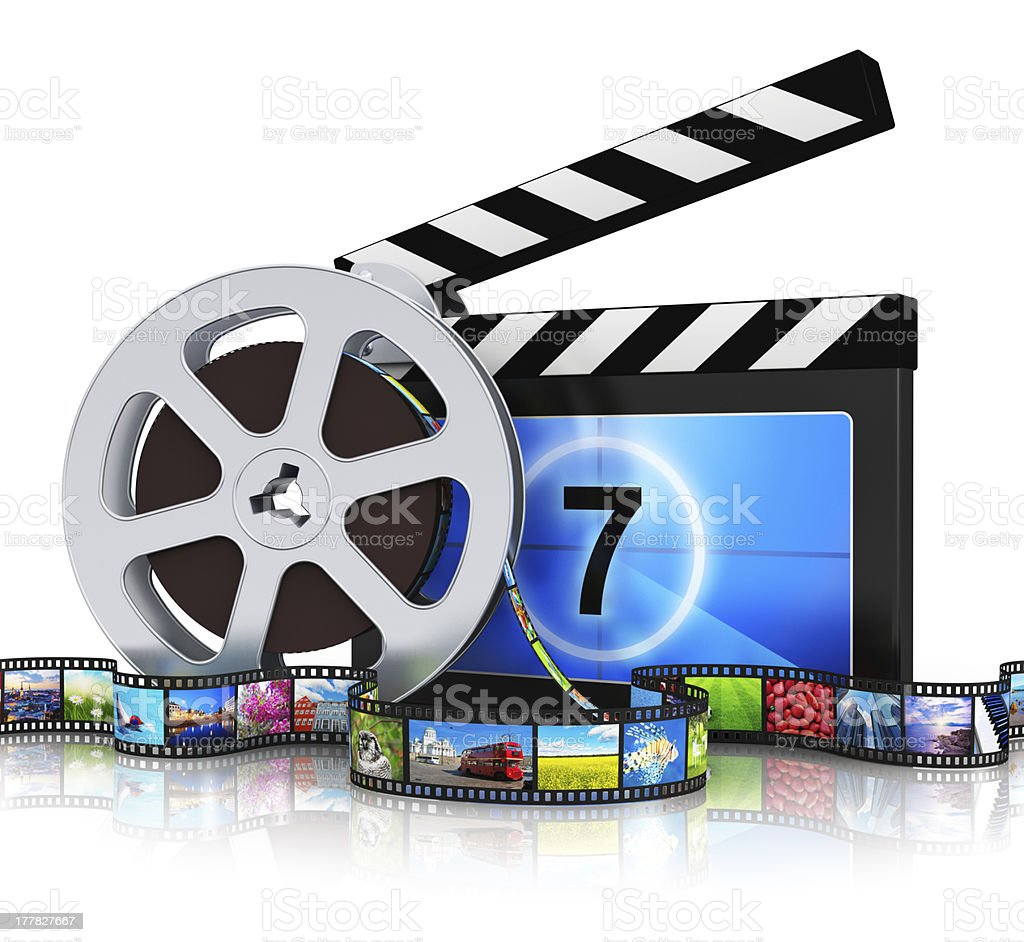 Clapper board, film reel and filmstrip stock photo
