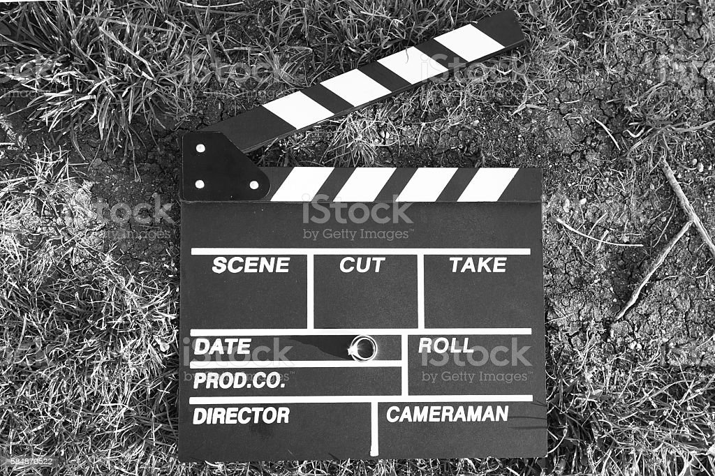 clapper board with an engagement ring stock photo