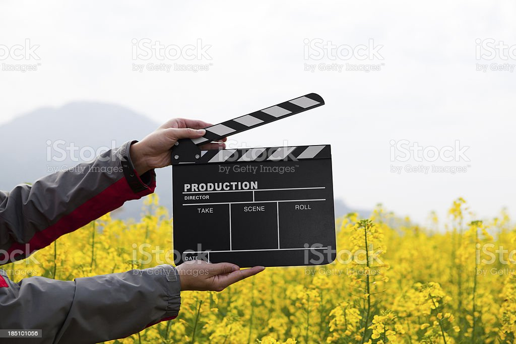 clapper board with hand royalty-free stock photo