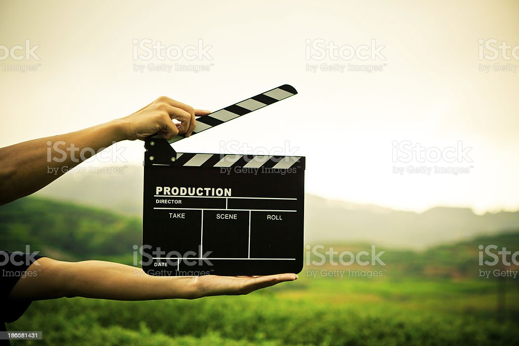 clapper board with hand stock photo