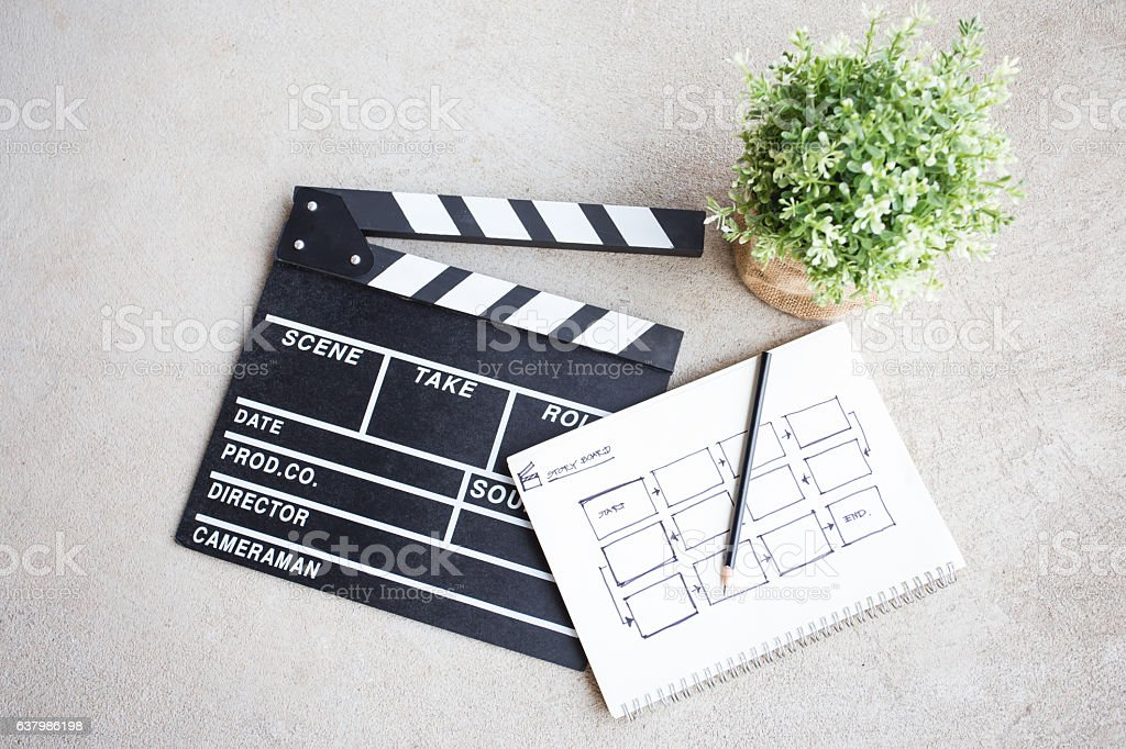 clapper board with sketch book stock photo