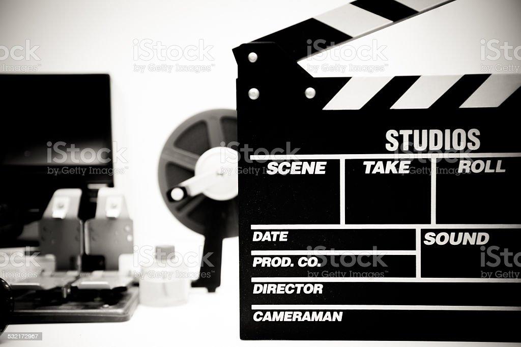 Clapper board with vintage movie editing desktop stock photo