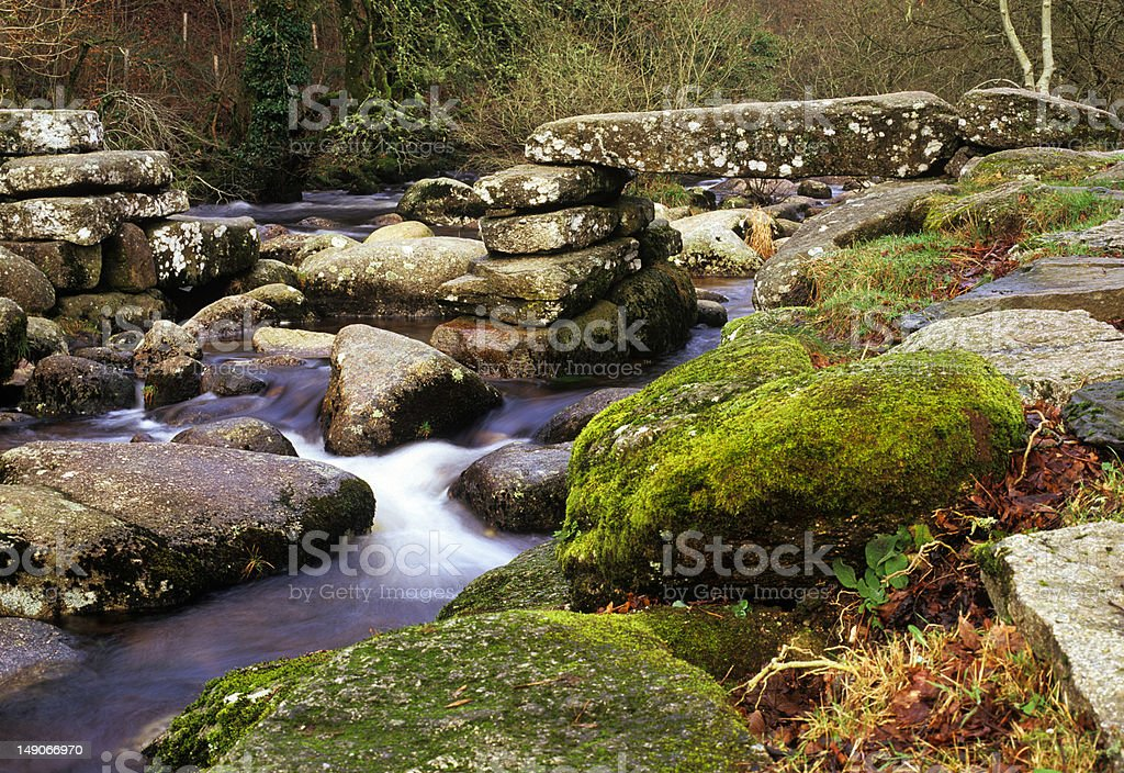 Clapper bridge at Dartmeet, Dartmoor, UK stock photo