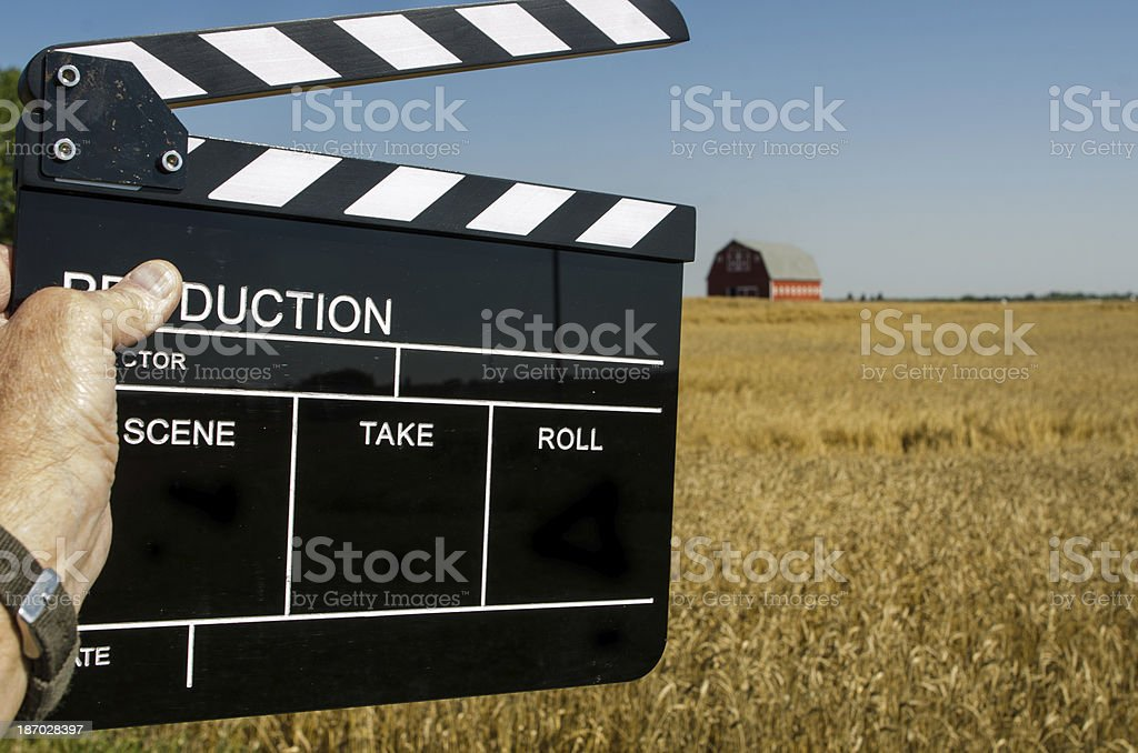 Clapper in front of a large field with barn royalty-free stock photo
