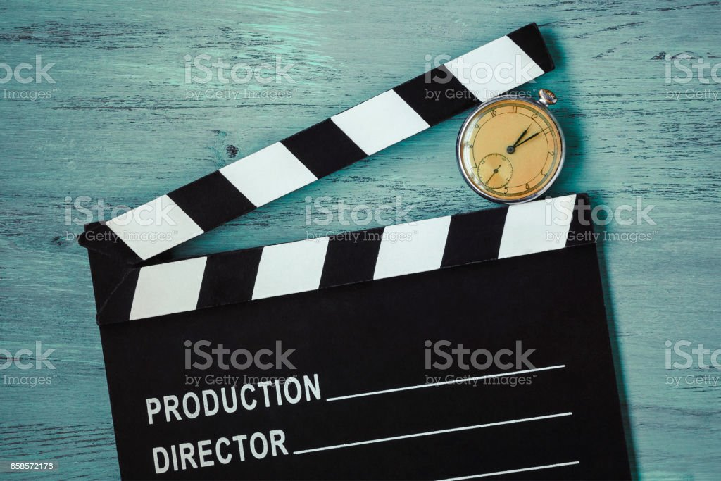 Clapperboard and clock stock photo