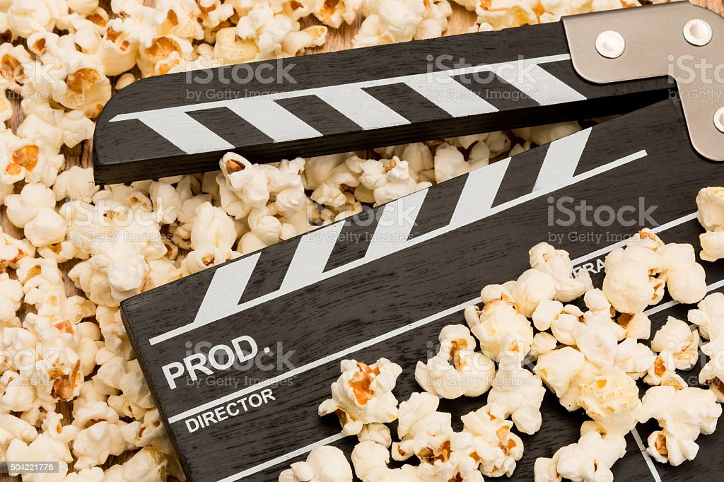 Clapperboard and popcorn stock photo
