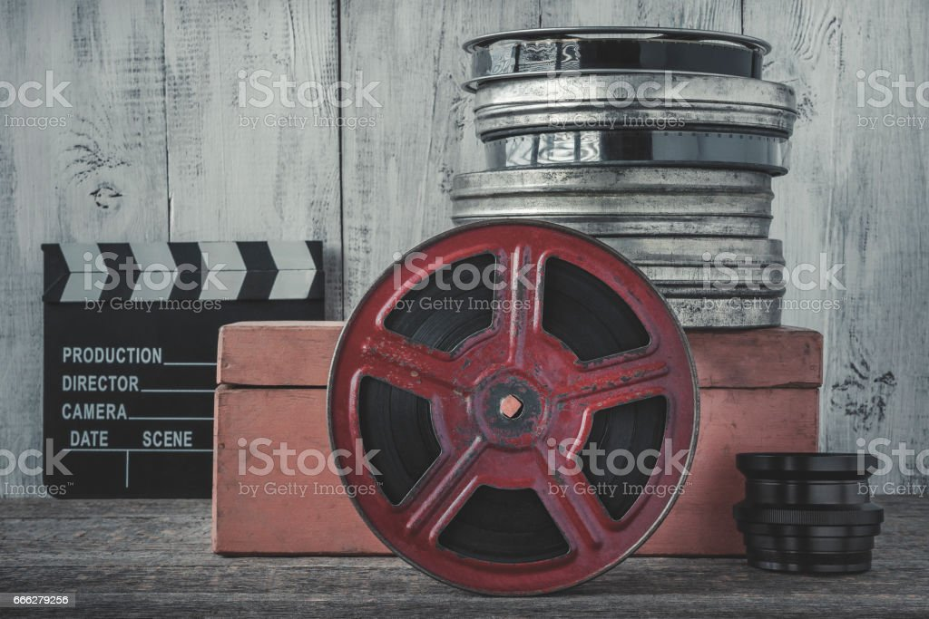 Clapperboard and the reel of film stock photo