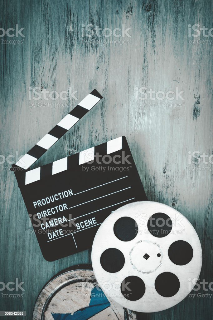 Clapperboards and the reel of film stock photo