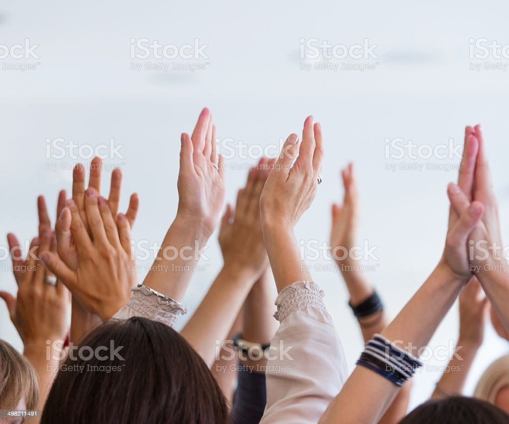 Clapping hands stock photo