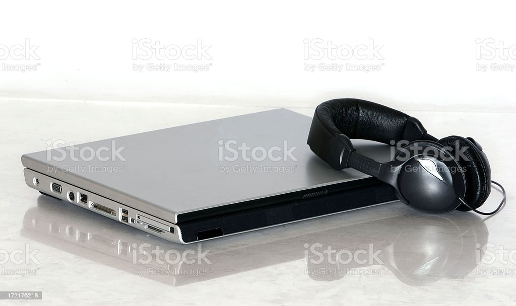 claptop with earphones stock photo